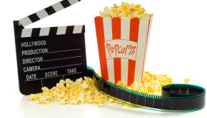 Movie and entertainment industry items including a box of popcorn a movie clapboard and a strip of 35mm film