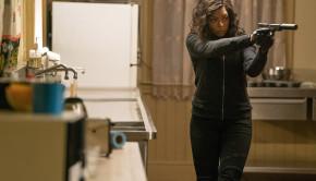 Mary (Taraji P. Henson) stalks her prey in the kitchen of the Kozlov mansion in Screen Gems' PROUD MARY.