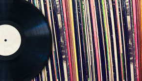 Vinyl record with copy space in front of a collection of albums (dummy titles), vintage process